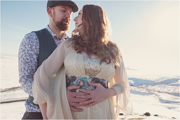 An Iceland engagement shoot. Rolling hills of snow, blue skies, and a sequin dress from The Couture Company. Photos by Rebecca Douglas Photography.