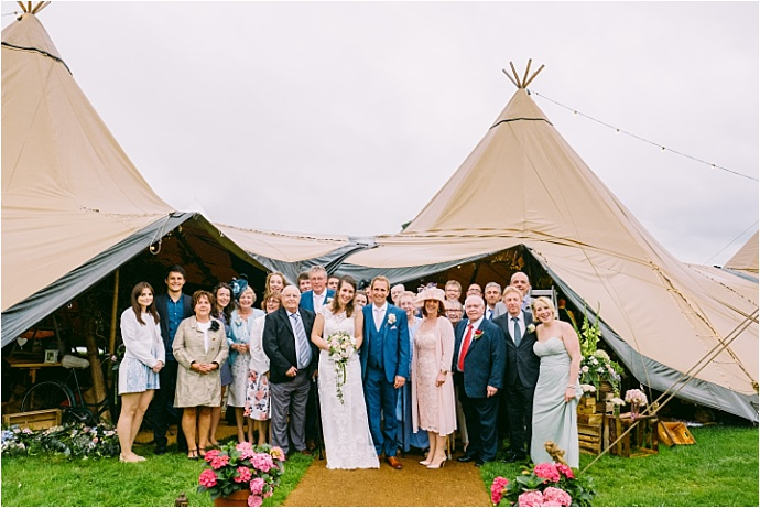 Tipi garden wedding filled with stunning arrangements and vintage touches. Photos by Kevin Belson Photography