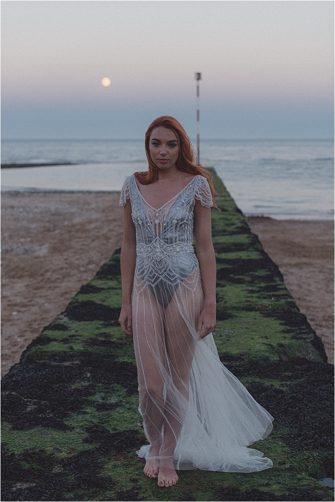 Nautical bridal shoot by the sea, inspired by the 'The Siren' - mythical creatures of the sea who lured sailors to shipwreck. Photos by Rebecca Douglas