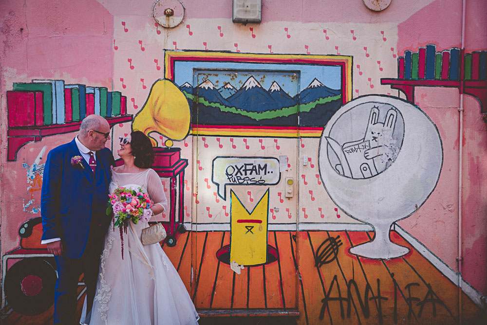 graffiti, brighton streets, blue wedding suit, vintage wedding dress, colourful wedding bouquet, bespoke wedding dress, brighton pavillion, brighton wedding, colourful, colourful wedding, d.i.y wedding, diy wedding, fun, glitter, laidback, mod wedding, non tradtional wedding, party, personalised, rainbow, ribbons, unique wedding, vintage