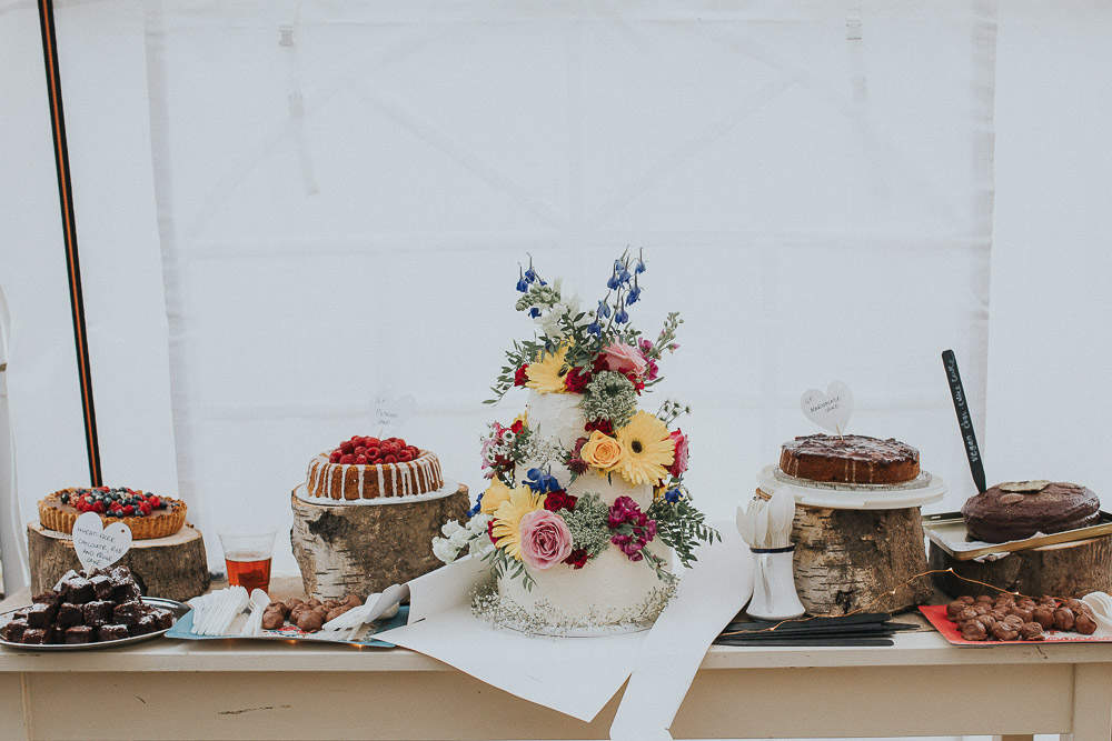 dessert table, cake table, wedding cake, wedding cake table, alternative wedding dress, Colourful wedding, cool bride, cool groom, DIY wedding, eco friendly wedding, festival vibe, festival wedding, floral crown, fun wedding, ginger bride, gluten free catering, Handmade wedding, joasis photography, mulberry lodge, mulberry lodge weddings, outdoor wedding, pom poms, quirky bride, red hair bride, relaxed wedding, rustic wedding, Smugglers, vegan catering, vintage wedding dress, wedding games, woodland wedding