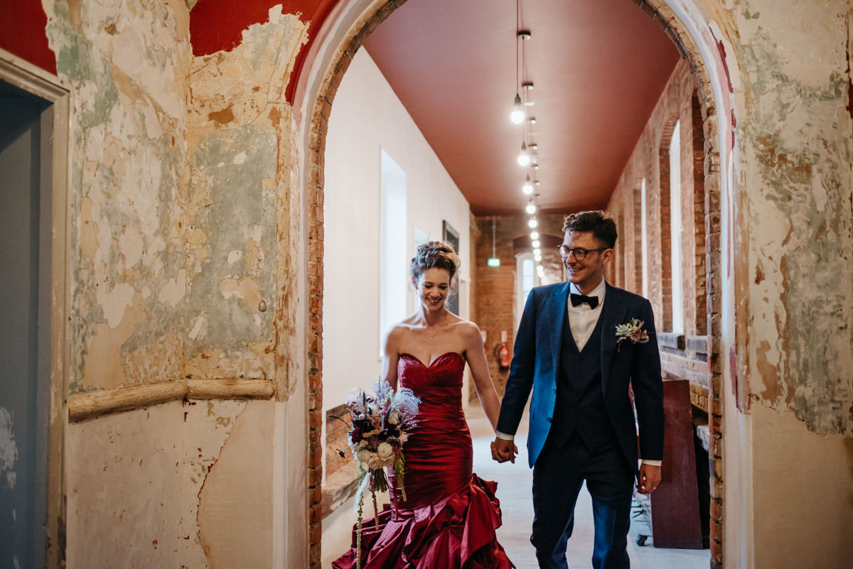 alternative wedding, battersea arts centre, bouquet, bridal style, bride, bride and groom, bride style, british wedding, candles, classy, colourful, cool bride, decadent, dress, foliage, glamour, london, london venue, london wedding, modern, navy and gold, non tradtional wedding, personal, red wedding dress, scarlet red dress, stylish, unique, unique bride, unique wedding, wedding, wedding dress