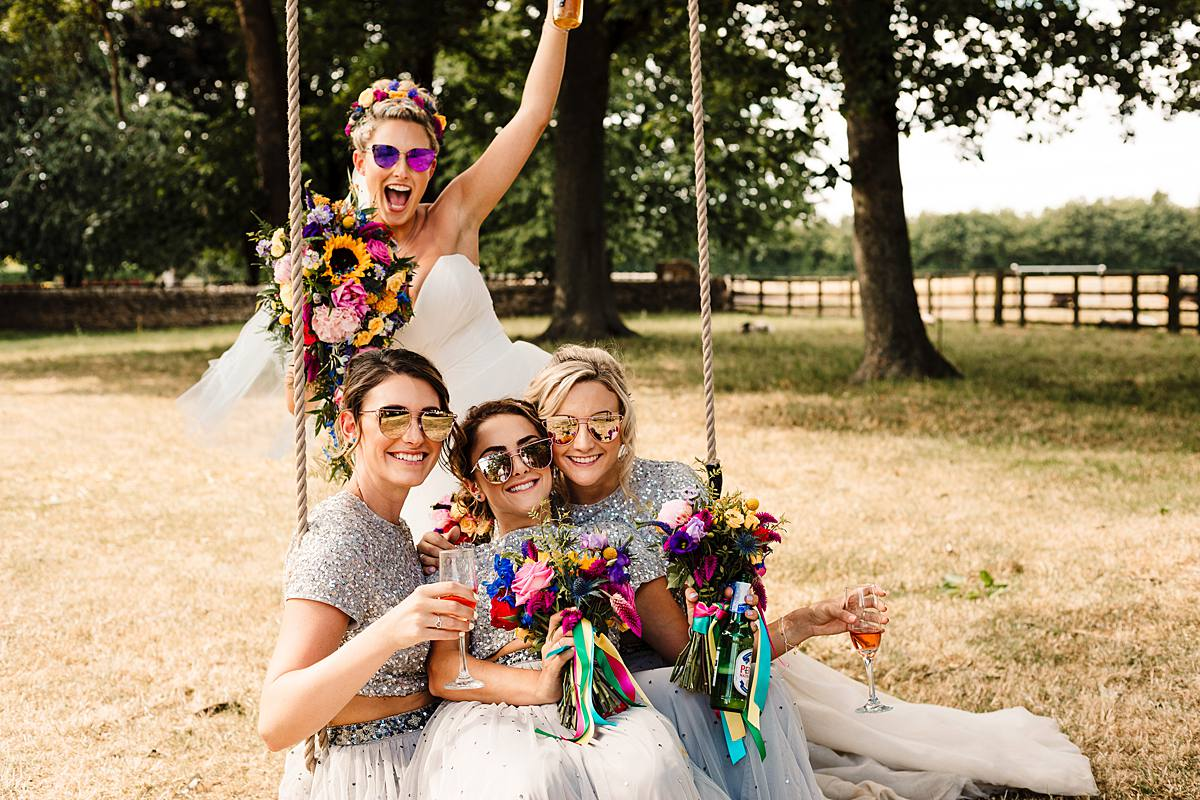 Mr and Mrs Unique, Tipi Wedding, Bright Wedding, DIY Wedding, Doncaster Wedding, Outdoor Wedding, Hip to Heart Photography, Pom Poms, Open Tipi, Giant Tipi, Flower Crowns, Vodka Jelly Shots, Fun Wedding, Sparkly Wedding Dress, Festival Style Wedding, Wedding Party, Sunflowers, Sunflower Bouquet, Church Wedding, Dogs, Sparkly Heels, Bridal Shows, Colourful Confetti, Loversall Farm,Yorkshire Wedding
