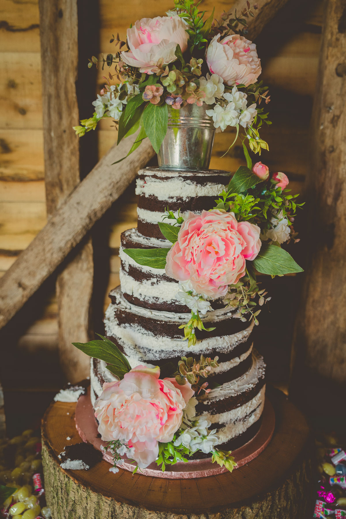 naked wedding cake with peonies