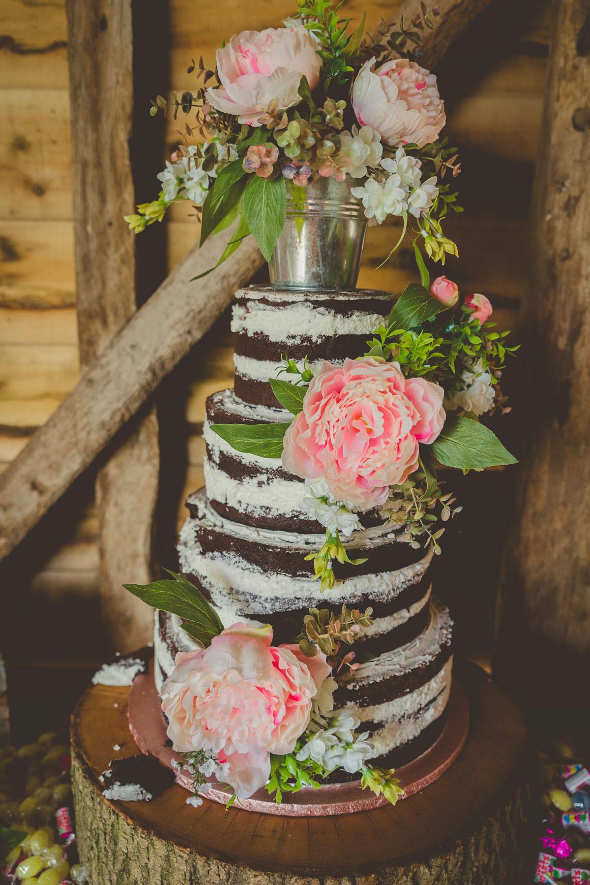 naked wedding cake with peonies