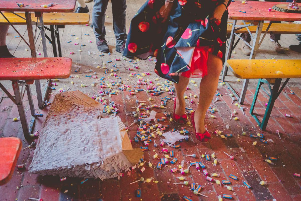 smash the piñata and sweets coming down