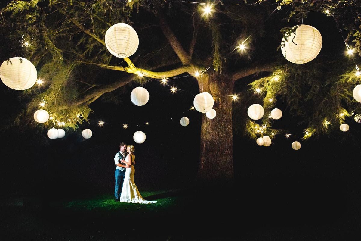 Lanterns in Elmore Court Garden at nighttime