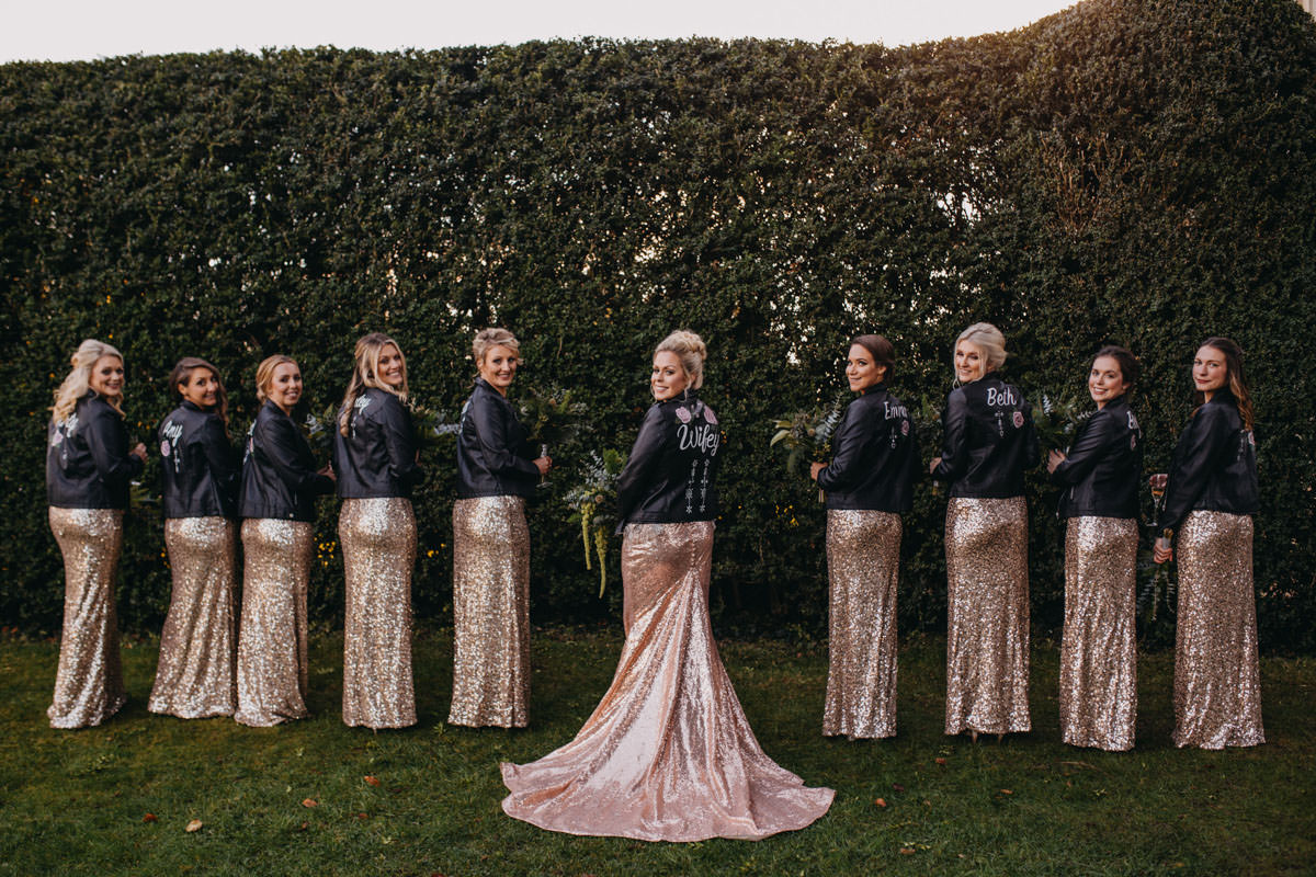 Bridal squad with sequin dresses and leather jackets at Elmore court