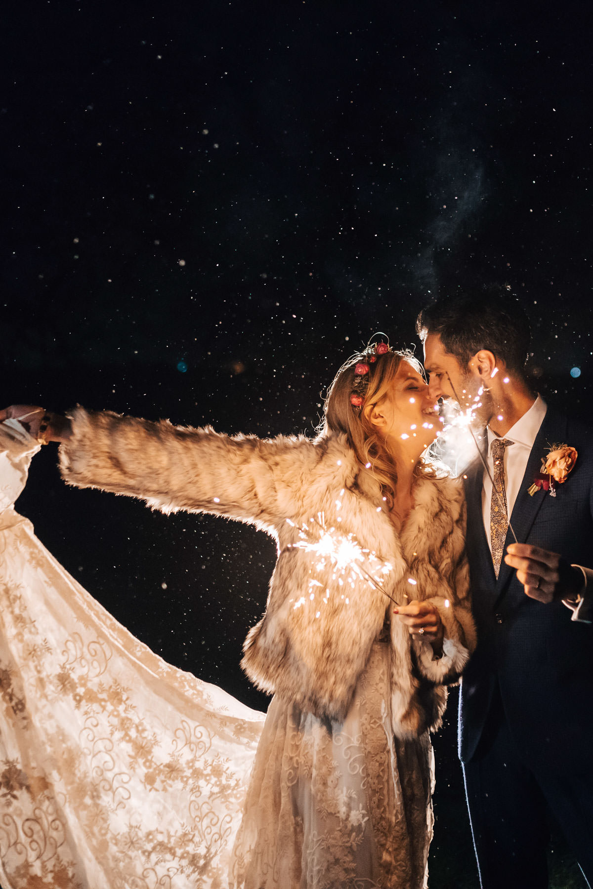bride and groom kissing with Sparklers at Elmore Court