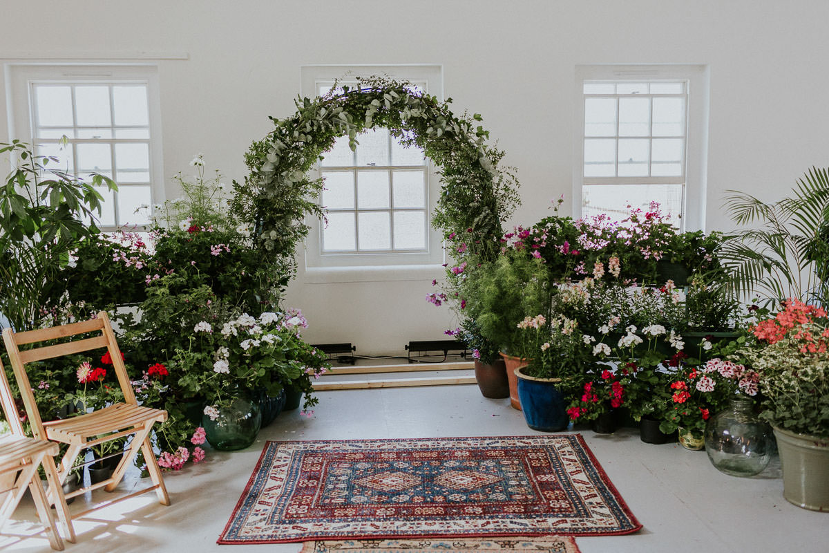 London Wedding at Core Clapton: floral wedding ceremony backdrop