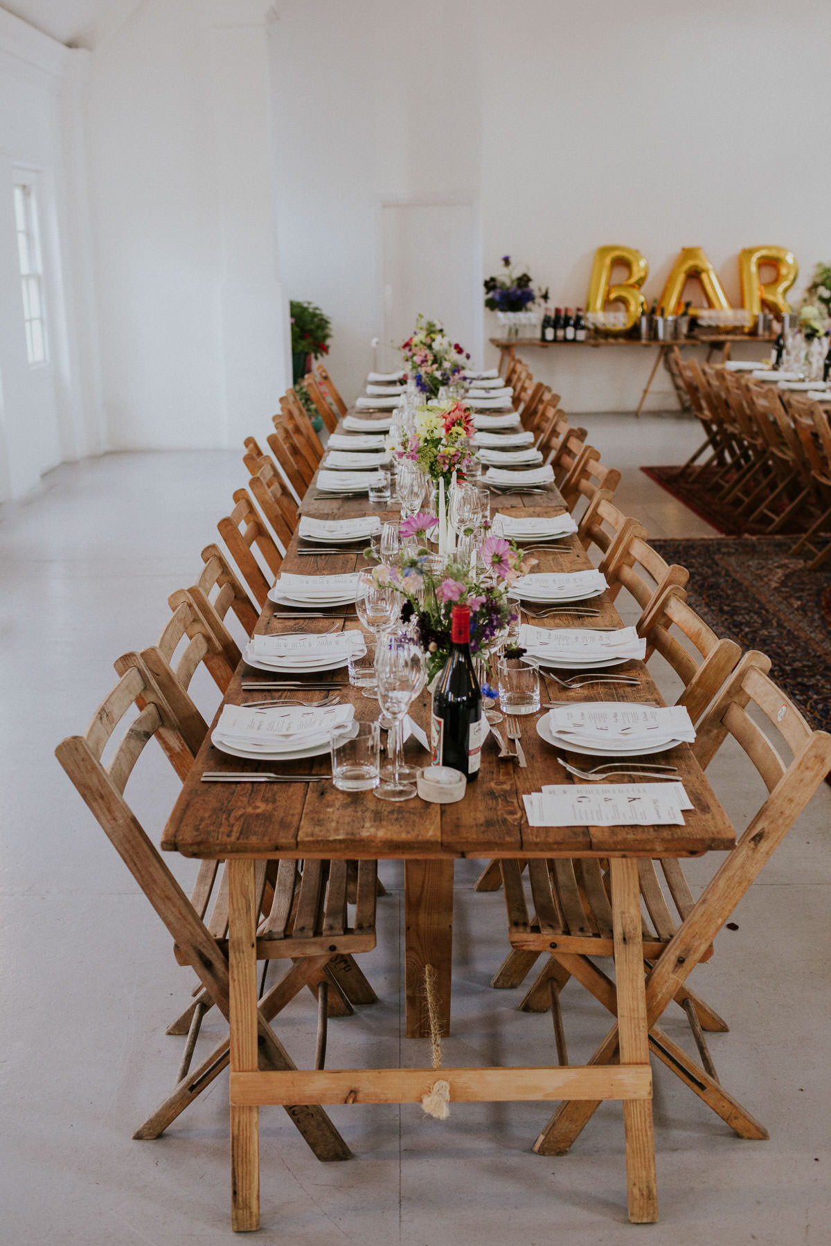 London Wedding at Core Clapton: Cool DIY wedding tables cape with rustic tables and chairs
