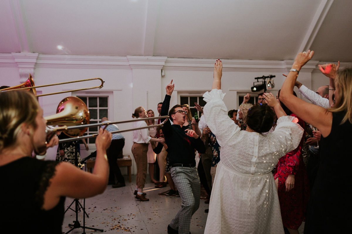 London Wedding at Core Clapton: wedding party and brass band