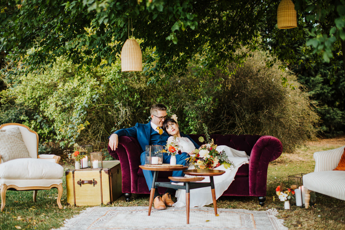 Bohemian Wedding Inspiration: Outdoors lounge area for wedding guests