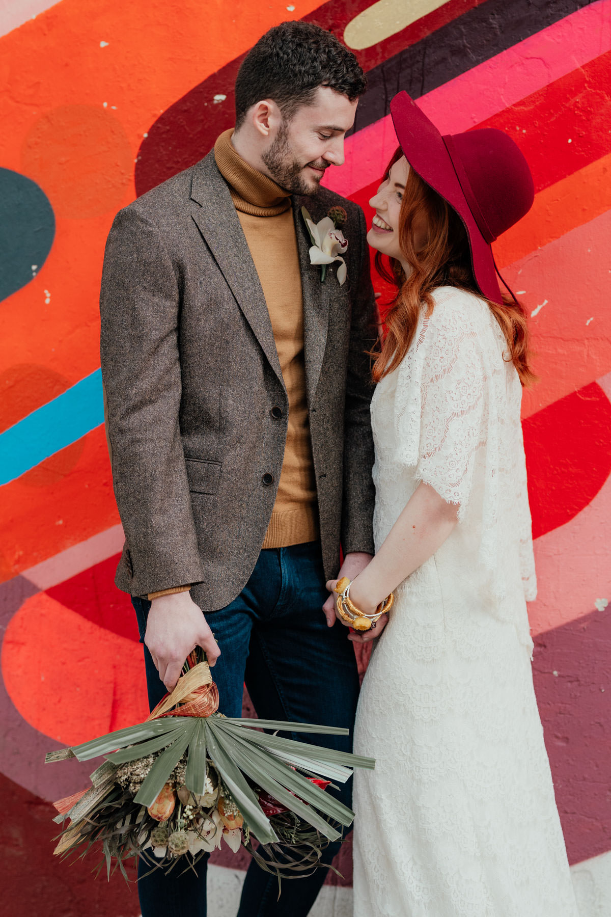 Industrial Meets Boho Wedding Inspiration: Cool couple portrait with graffiti background