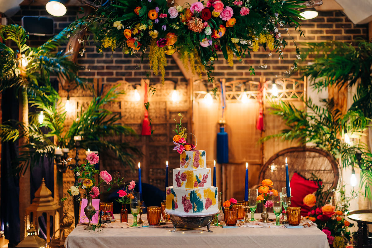 abstract cake, bohemian bride, bohemian wedding inspiration, chaise lounge, Colourful Wedding, Colourful wedding styling, Dapper and Suave, glitter at weddings, harriet Bird Photography, Louise Rose Couture, marrakesh weddings, moroccan rugs, Moroccan wedding, moroccan wedding inspiration, Moroccan wedding props, Moroccan wedding styling, organic cake, organic wedding cake. wedding feast, peacock chair, sussex wedding photographer, the giraffe shed, vibrant wedding, Wedding feasts, West sussex wedding