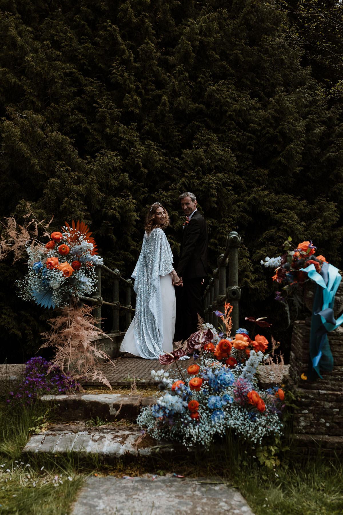 disco wedding, elopement, elopement ceremony, festival bride, festival wedding, floral boat, pix by vix, retro inspired wedding, sequin cape, wild disco theme, wilde posies, woodland elopement